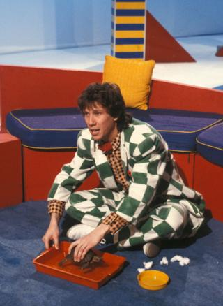 Peter Duncan with the Blue Peter tortoise, George in 1986