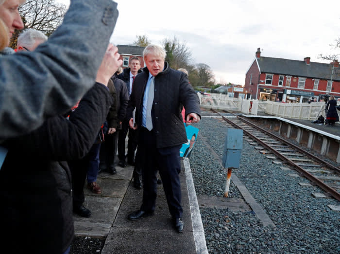 Britain's Prime Minister Boris Johnson gestures during a general election campaign trail stop at Thornton-Cleveleys railway station in Manchester, Britain November 15, 2019. Frank Augstein/Pool via REUTERS - RC2TBD9GD9RD