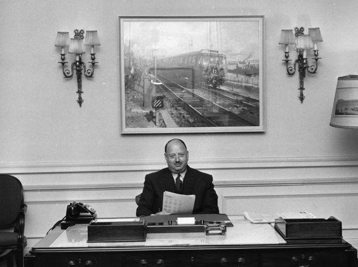 Dr Richard Beeching (1913 - 1885) sitting at his desk, soon after his appointment as head of British Rail. (Photo by Evening Standard/Getty Images)
